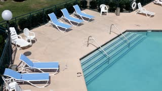 Empty Pool chairs by water