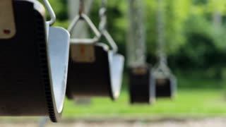 Empty swings in playground close up
