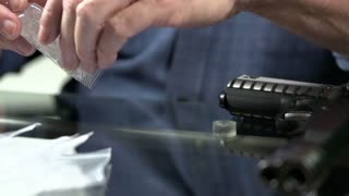 Emptying drugs onto table in slow motion