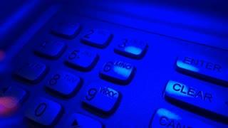 Entering secret number on ATM at night