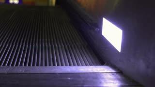 Escalator at night close up on track 4k