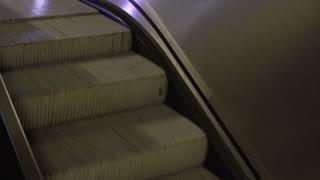 Escalator running downwards at night