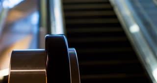 Escalator system focused on rail going up 4k