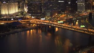 Establishing of Pittsburgh skyline at night tilt shot