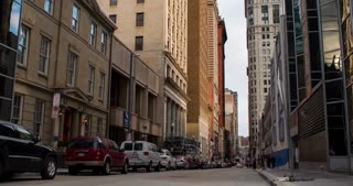 Establishing shot of back city street camera tilt Pittsburgh 4k