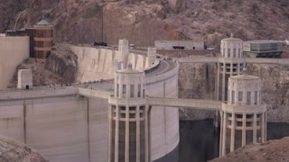 Establishing Shot Of Hoover Dam With Car Traffic Crossing From Arizona To Nevada 4K