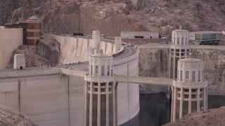 Establishing Shot Of Hoover Dam With Car Traffic Crossing From Arizona To Nevada 4K