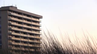 Establishing shot of ocean side apartment complex at sunset 4k
