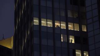 Establishing shot of office building at night 4k
