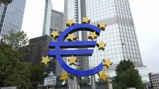 Euro symbol in downtown Frankfurt Germany business district 4k