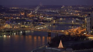 Evening aerial shot of Pittsburgh downtown with Christmas tree 4k