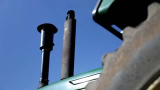 Exhaust from tractor on blue sky