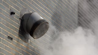 Exhaust ventilation system with smoke coming out on side of building 4k