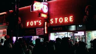 Exterior Foy's Halloween shop at night