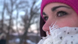 Eyes of woman in cold winter weather with scarf on