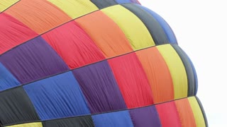 Fabric of hot air balloon blowing in wind