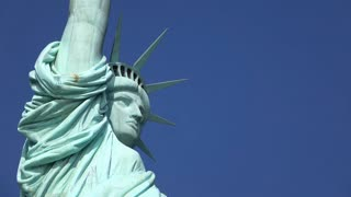 Face of Statue of Liberty on blue sky 4k