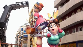 Fallas sculpture being assembled in downtown Valencia Spain