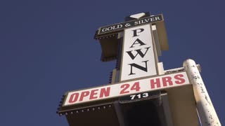 Famous Gold and Silver pawn shop sign establishing shot 4k