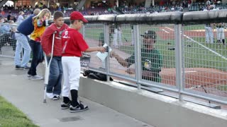 Fans getting signature at Dayton Dragons Game