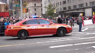 FDNY emergency vehicle with lights flashing in Macys Parade 4k
