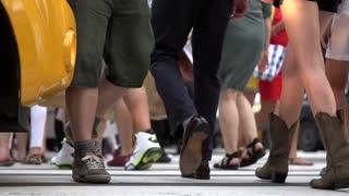 Feet crossing sidewalk slow motion