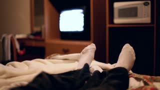 Feet in Bed watching TV