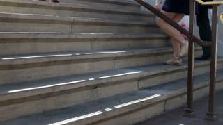 Feet walking up Concrete Steps