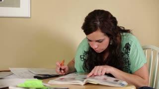 Female browsing catalog and circling items