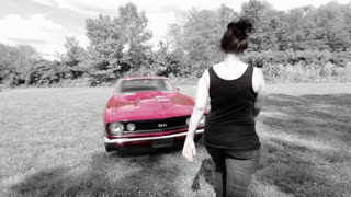 Female getting into beautiful classic car effects