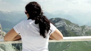 Female looking into the distance of Mountains