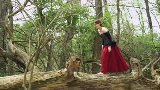 Female running through woods with bare feet 4k