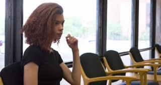 Female sitting in waiting room 4k