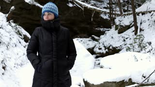 Female standing in Snow hiding mouth