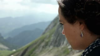 Female thinking in nature with Mountains in back