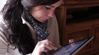 Female using touchscreen tablet