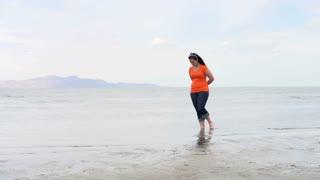 Female walking through Great Salt Lake