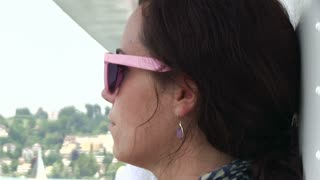 Female with sunglasses on boat ride