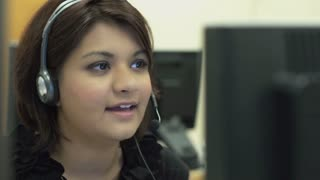 Female working at a call center computer