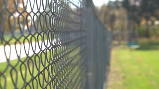 Fence along side of street with focus on linkage 4k