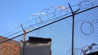 Fence covered with barb wire to keep people out 4k