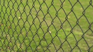 Fence protecting playground tilt shot 4k