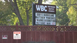 Fenced in yard of Westboro Baptist Church with high security 4k