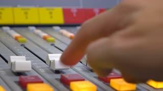 Finger controlling sound board at music studio 4k