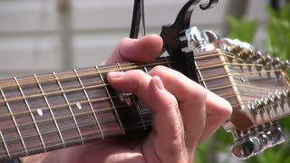Fingers Playing Guitar Strings