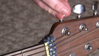 Fingers Tuning Guitar