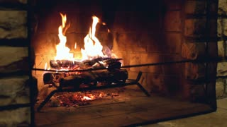 Fire Burning in fireplace of home