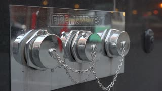 Fire pump test outlets on building in city 4k