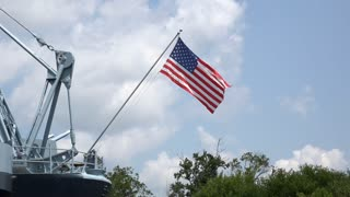 Flag on military navy vessel waving proud 4k