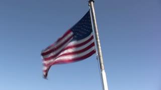 Flag Waving on Back of Boat